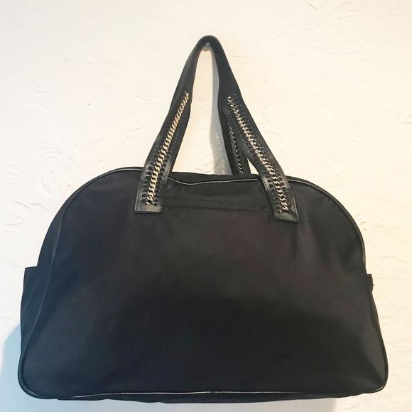 32916d20429 Calvin Klein Black Nylon Weekender Duffel. Calvin Klein.  M_5b2fa3d245c8b3710990dada. M_5b2fa3d2c2e9fe2e3efc8082.  M_5b2fa3d2819e90b64e68b0a9